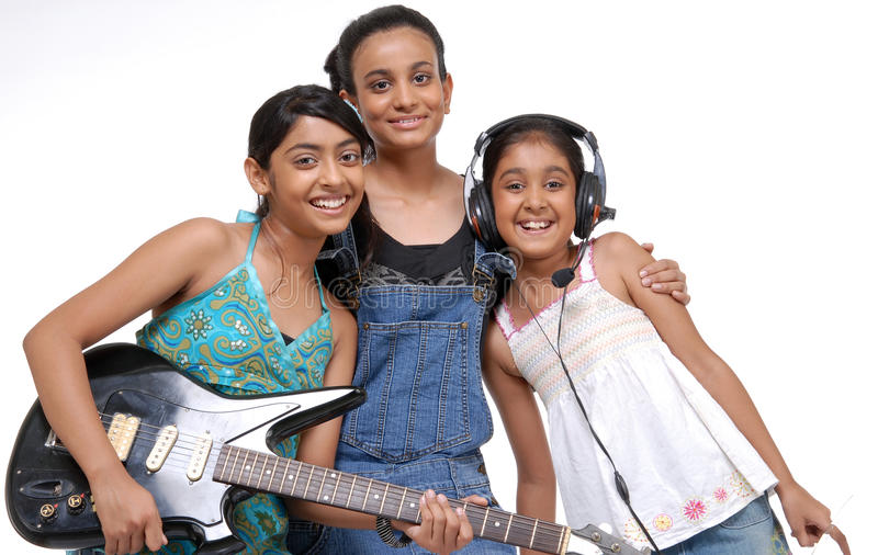 Indian Children music band. Indian girls music band over white background royalty free stock image