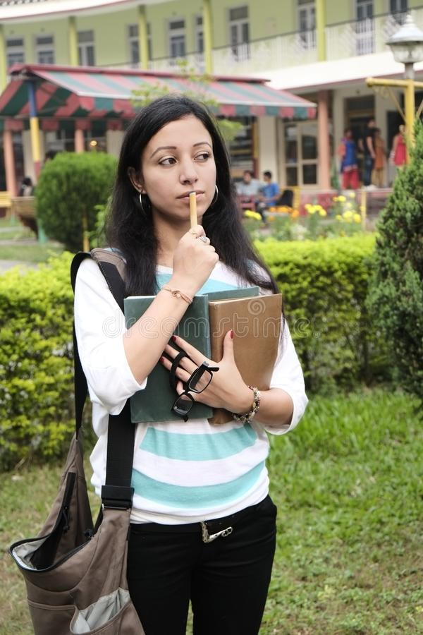 Indian college student is busy thinking royalty free stock photos