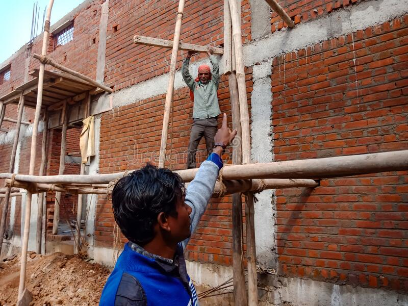 an indian contractor giving instructions to the labour during building construction in india January 2020 royalty free stock photos