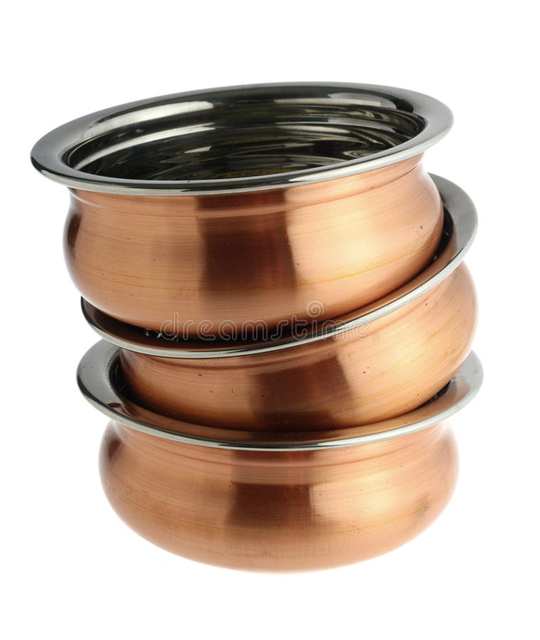 Indian copper-plated bowls with shadow stock image