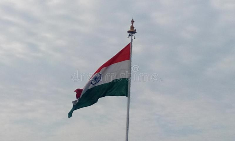 Indian country Flag in front of Chennai Airport as an symbol of patriotic. Picture of India country flag in a flagpole in front of chennai international airport stock photo