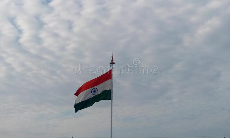 Indian country flag of India floating and waving in the air. Picture of India country flag in a flagpole in front of chennai international airport as an royalty free stock photo