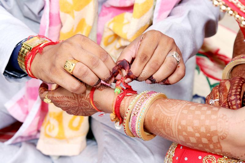 Indian couple playing Ring Fishing game in wedding. Ceremony of India stock images