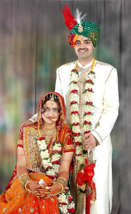 Download Indian Couple In Their Wedding Dress Stock Photo