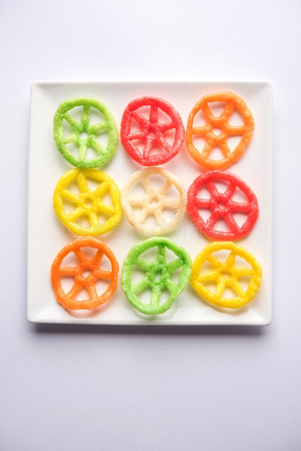 Indian crunchy fryums or papad snack in wheel, square and triangle shapewheel shape colourful fryums papad snack. selective focus royalty free stock image