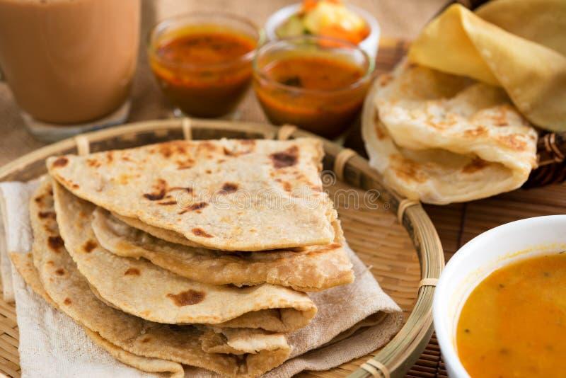 Indian cuisine. Indian food, Chapati flatbread, roti canai, dal, curry, teh tarik or pulled tea, acar. Famous indian cuisine stock photo