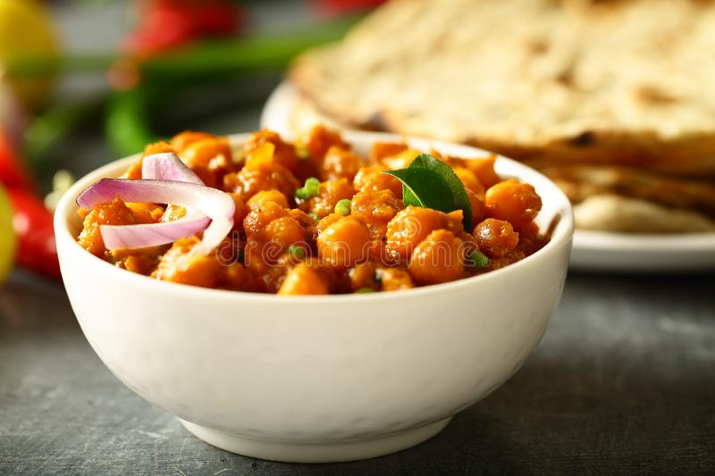 Homemade Chickpea curry.Indian vegan food. Indian cuisine- homemade chickpea curry,channa masala served with flat breads ,tandoori roti stock image