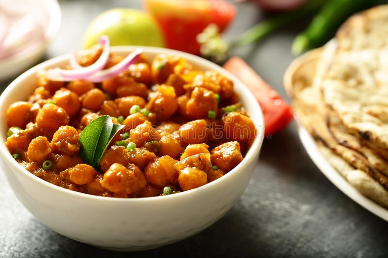 Homemade Chickpea curry served with roti. Indian cuisine- homemade chickpea curry,channa masala served with flat breads ,tandoori roti royalty free stock images