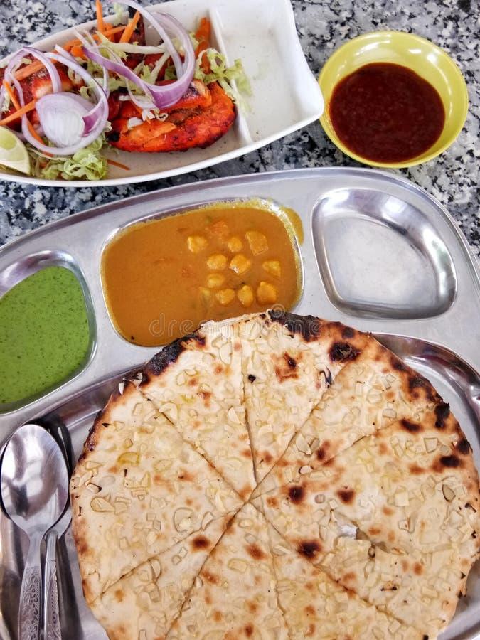 Indian Cuisine. Tandoori Chicken With Garlic Naan stock photography