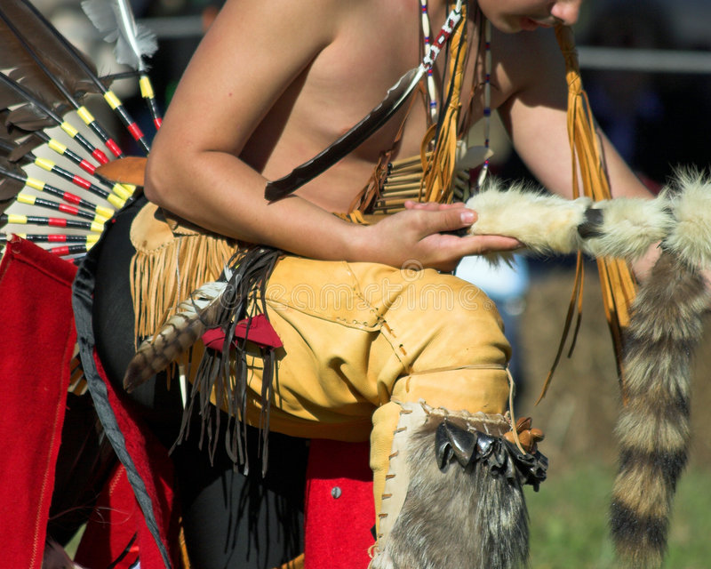 Indian culture. American indian doing a dance according to old time customs stock photos