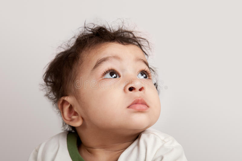 Indian curious kid. Looking at the camera on white background stock photography