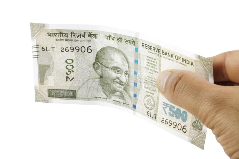 Indian Rupees in hand. Indian currency, five hundred rupees note held in hand. Giving Money stock image