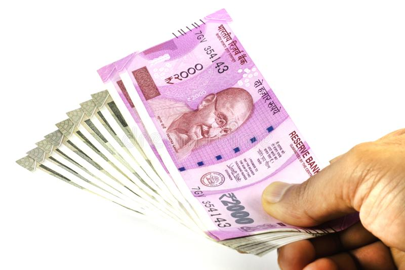 Indian Currency New Notes held in hand. Indian Money in Hand. Indian currency notes held in hand. Two thousand and Five Hundred Rupees Notes. New Indian Currency royalty free stock photography