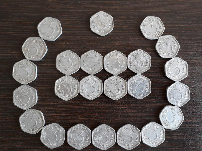 Indian currency 3 paisa stock images
