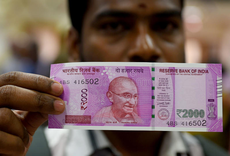 INDIAN CURRENCY,TWO THOUSAND RUPEE. Indian Currency, Two thousand indian rupee in background, New currency introduced to curb Black Money.nPhoto taken on stock photo