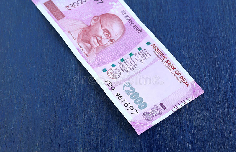 Indian Currency Two Thousand Rupees. With focus on the number 2000, on a wooden background stock photo