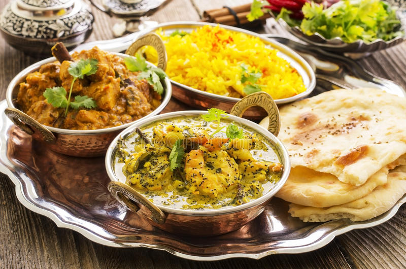 Indian Curries with Rice and Bread royalty free stock photos