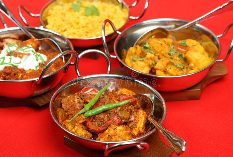 Indian Curries in Serving Dishes stock photo