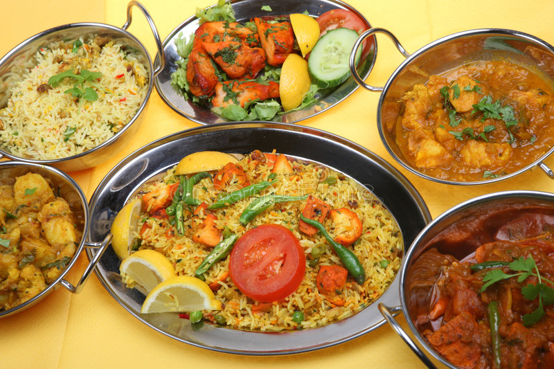 Indian Curry Food Meal Dinner. Selection of Indian curries on stainless steel serving dishes stock image