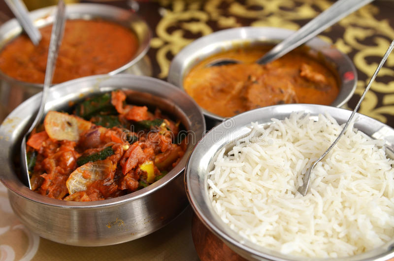 Indian curry meal. With balti dish and basmati rice stock photo