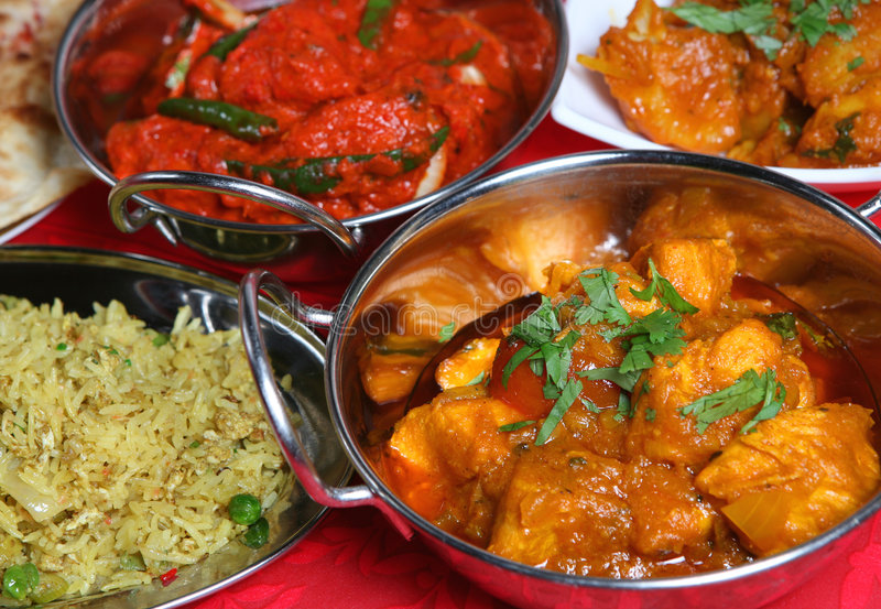 Indian Curry Meal Food. Indian curry meal with rice, nan and begetables royalty free stock photography
