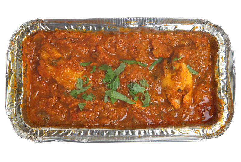 Indian Curry Takeaway. Indian chicken madras curry in aluminum foil container stock photos