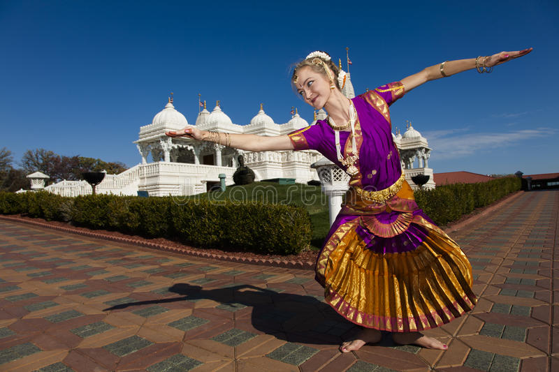 Indian Dancer by Hindu Temple royalty free stock image