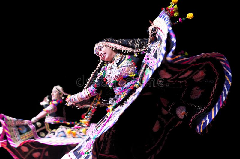 Indian Dancers in traditional clothes performing at festival in Rajasthan state, India royalty free stock photo