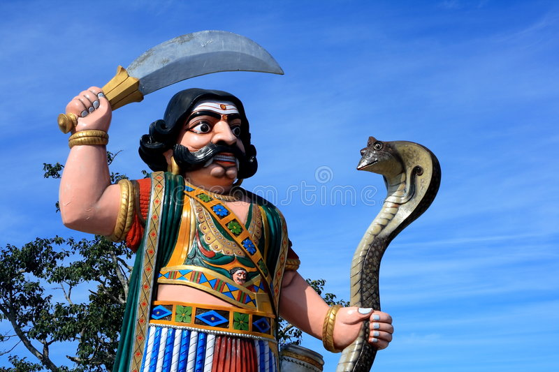 Indian Demon Statue With Snake Stock Photo