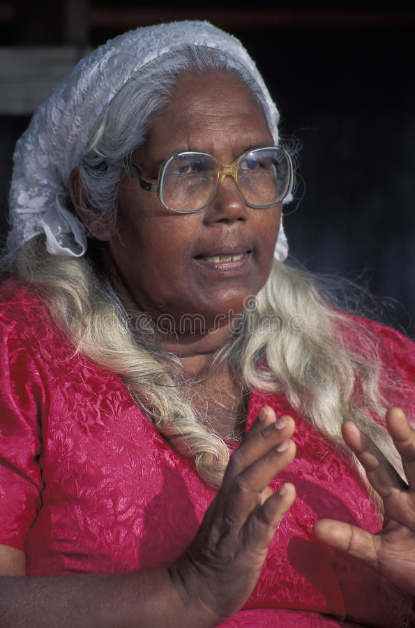 Indian descendant, Trinidad. After slavery was banned in the 1830s, indentured workers from India were brought to Trinidad, West Indies. Their descendants now royalty free stock photo