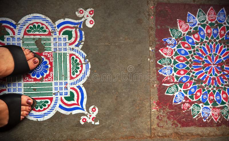 Indian Design with feet. This is the indian design on the floor at KR Flower Market in Bangalore, India royalty free stock photo