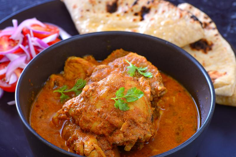 Indian meal-Chicken Curry served with salad and roti stock image