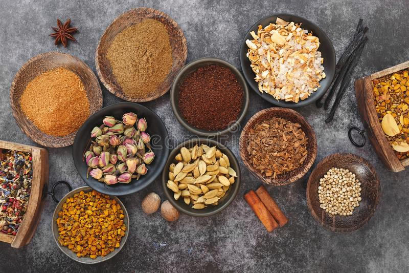 Indian dried spices and nuts in bowls royalty free stock photography