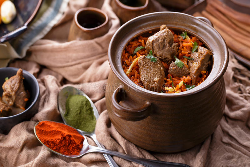 Indian dum biryani lamb. Portrait of indian dum biryani lamb served in a pot stock image