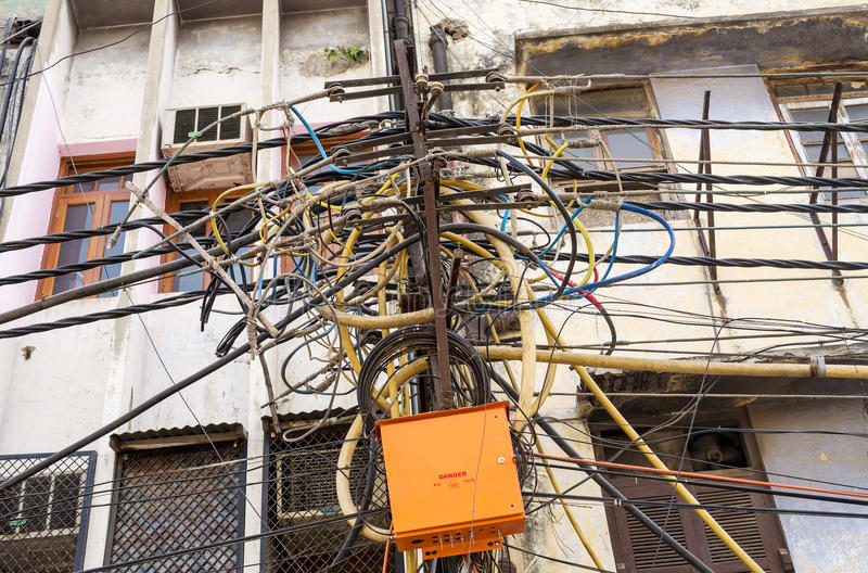 indian electricity pole stock photo image of interlaced 34064802 rh dreamstime com India Telephone Wiring Mess Funny Picture of Wiring Mess