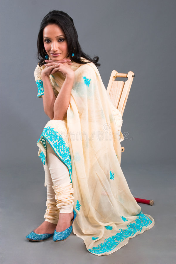 Indian Embroidered Women's Apparel. A model wearing a traditional Indian embroidered dress royalty free stock photo