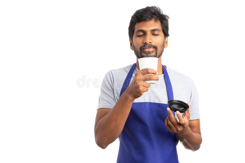 Indian employee smelling hot beverage during coffee break stock image
