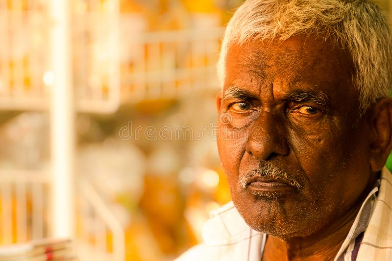 Indian ethnicity stall owner looks into the camera stock photos