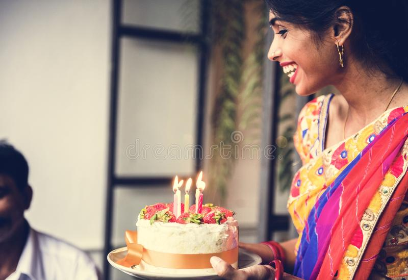 Indian family celebrating a birthday party stock images