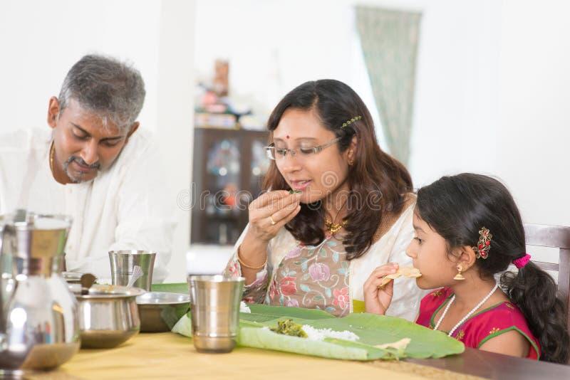 Indian family eating banana leaf rice royalty free stock photos