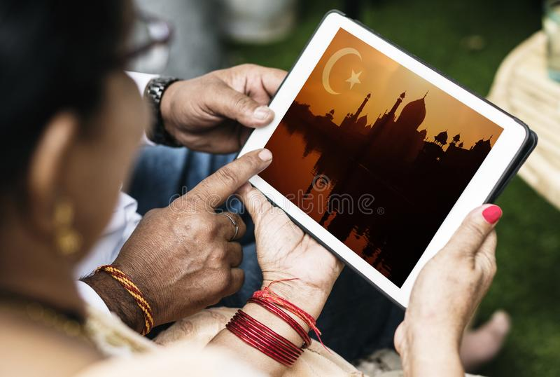 Indian family interested in Islamic design royalty free stock image