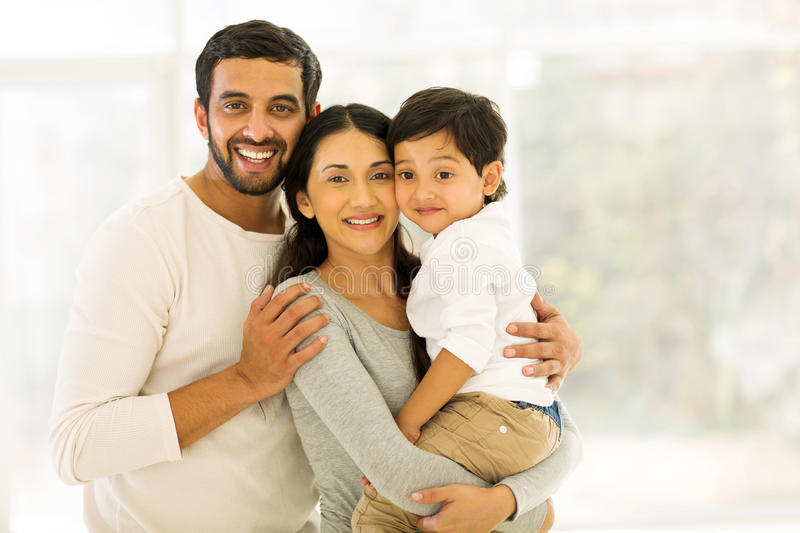 Indian family three. Portrait of happy indian family of three standing indoors