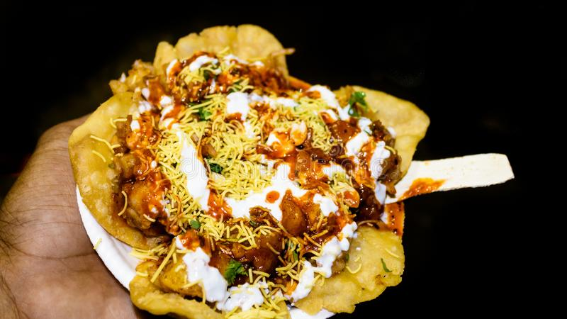 Indian famous Papdi Chaat Papri Chaat. A yummy snack assorted with crunchy base of Papdi crisp puris topped with lip-smacking stock photos