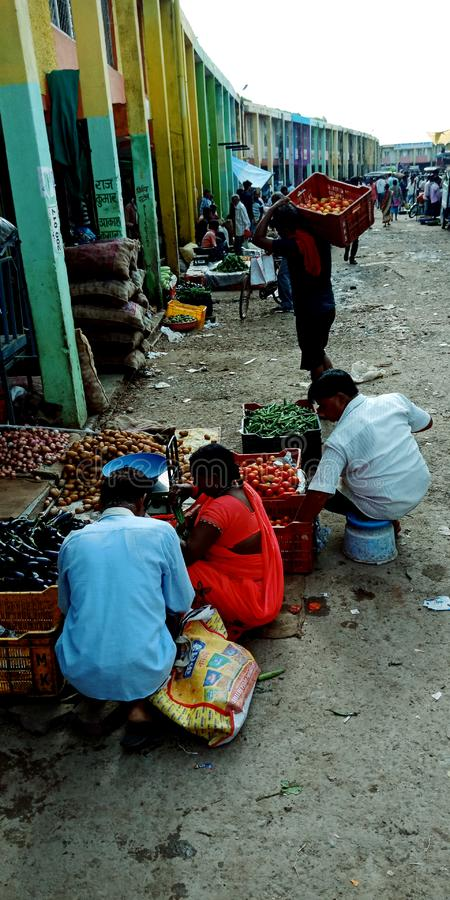 Indian farmers selling vegetables at wholesale distributor store royalty free stock photography