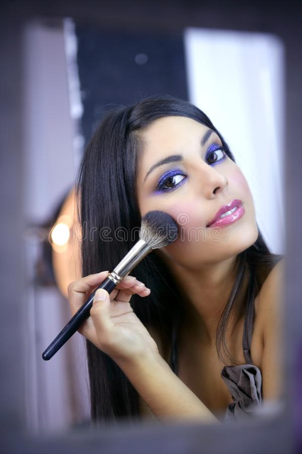 Indian fashion model makeup with brush stock photo