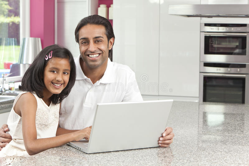Indian Father & Daughter Using Laptop Computer stock photo