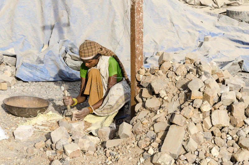 Indian Female worker. Rourkela,India, May 16 - Indian workers in a small Refractory industry busy in their work without any safety equipment.Men and Women both royalty free stock photo