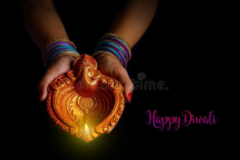 Indian Festival diwali , Lamp in hand royalty free stock images