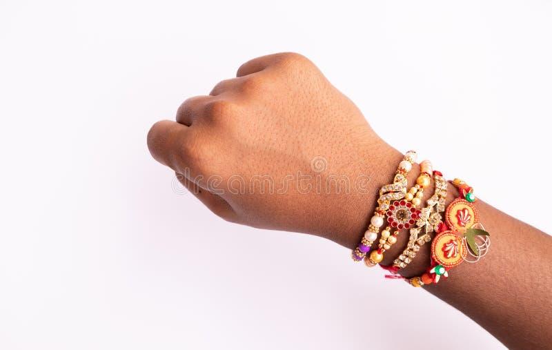 Indian festival Raksha Bandhan, raki or Raakhi on hand on  background stock photo