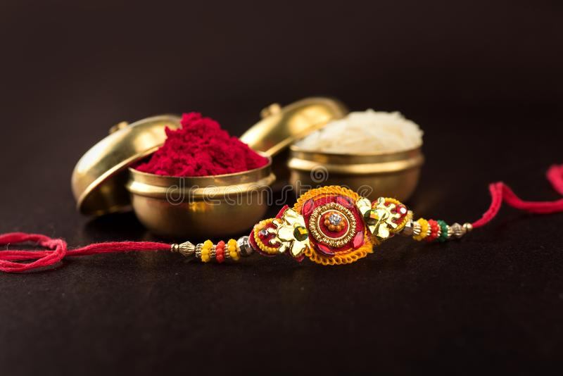 Indian festival: Raksha Bandhan.A traditional Indian wristband which is a symbol of love between Brothers and Sisters. stock photos